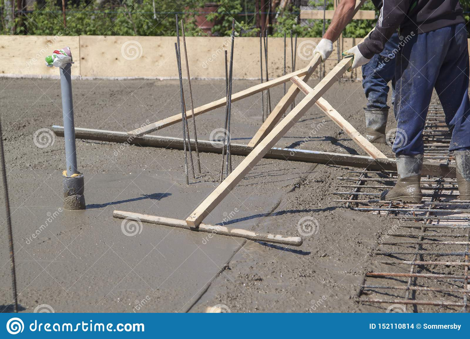 Workers Leveling Fresh Concrete Slab With A Special Working Tool Stock Photo Image Of Casting Industry 152110814