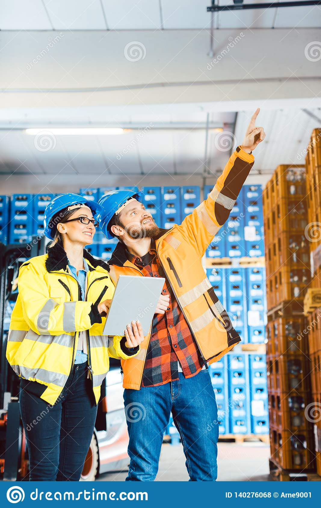 Workers in a logistics warehouse planning the next project