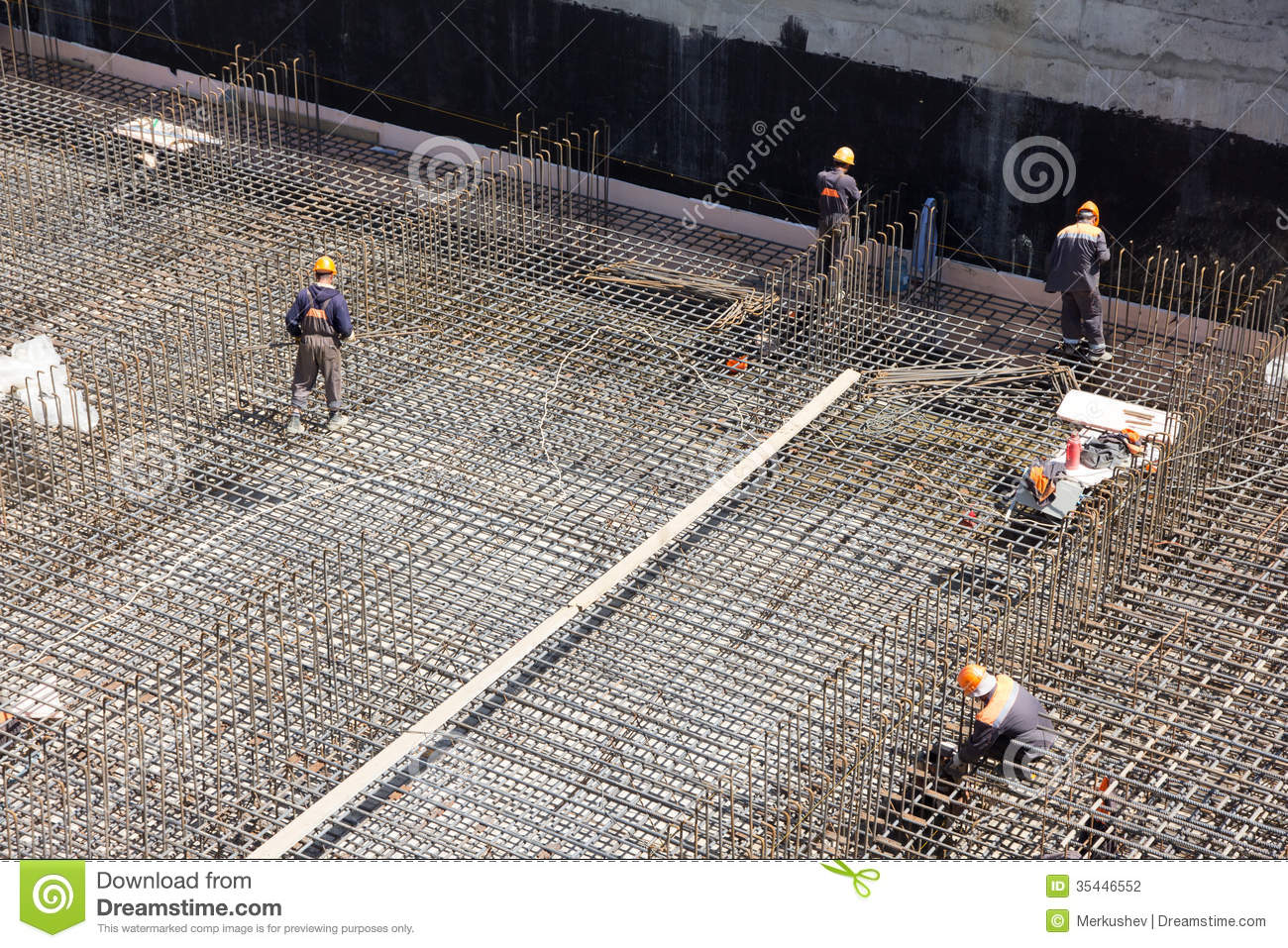 Workers Make Reinforcement For Concrete Foundation Stock
