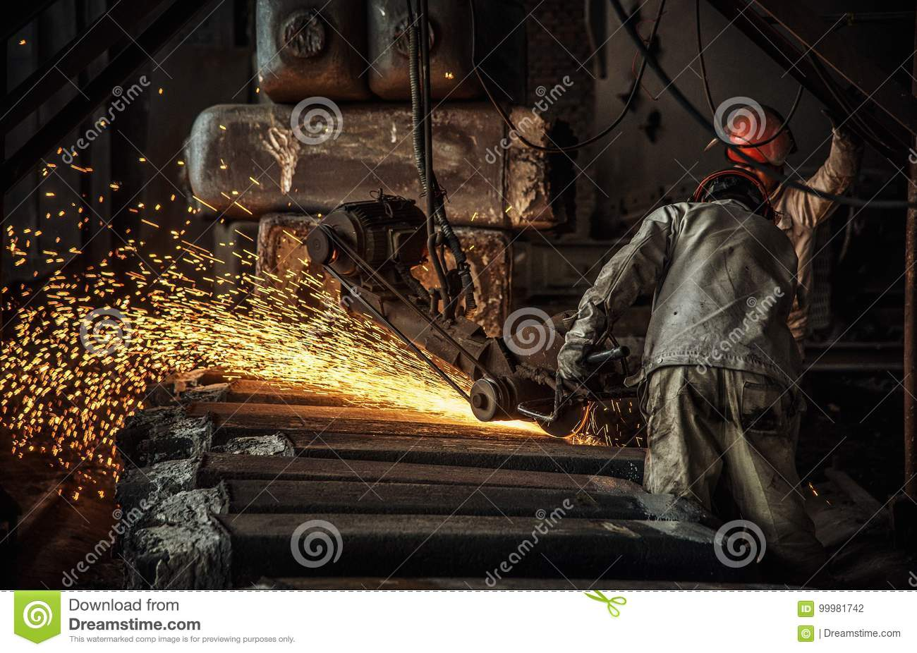 The workers in the steel mill are burnishing the steel