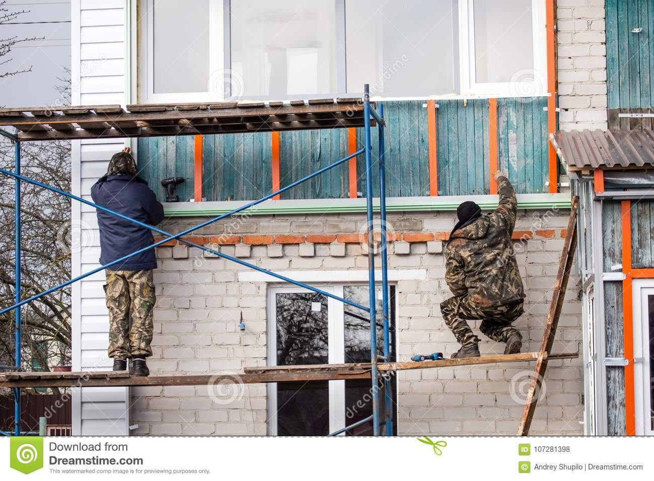 workers walling the house with wall siding stock photo image of rh dreamstime com house with wall clock house with wall tiles