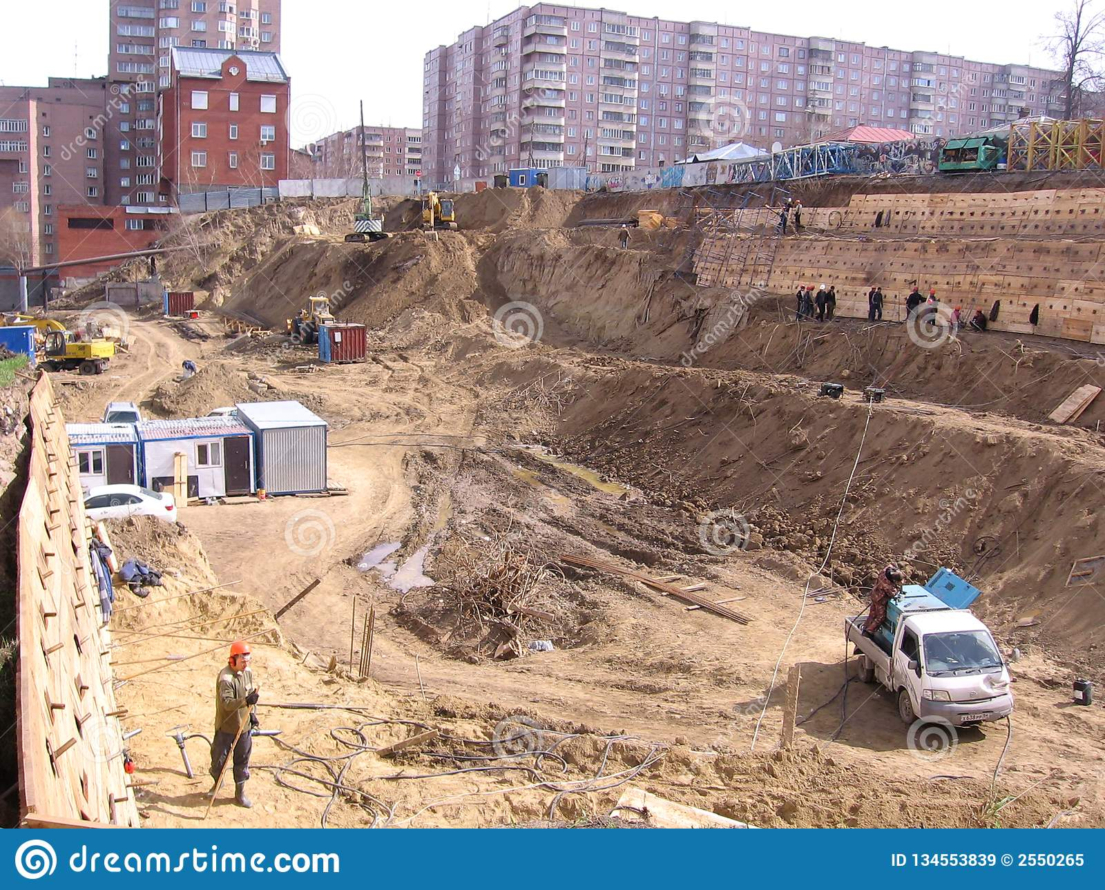 с русс working builders strengthen a large pit with wooden floors