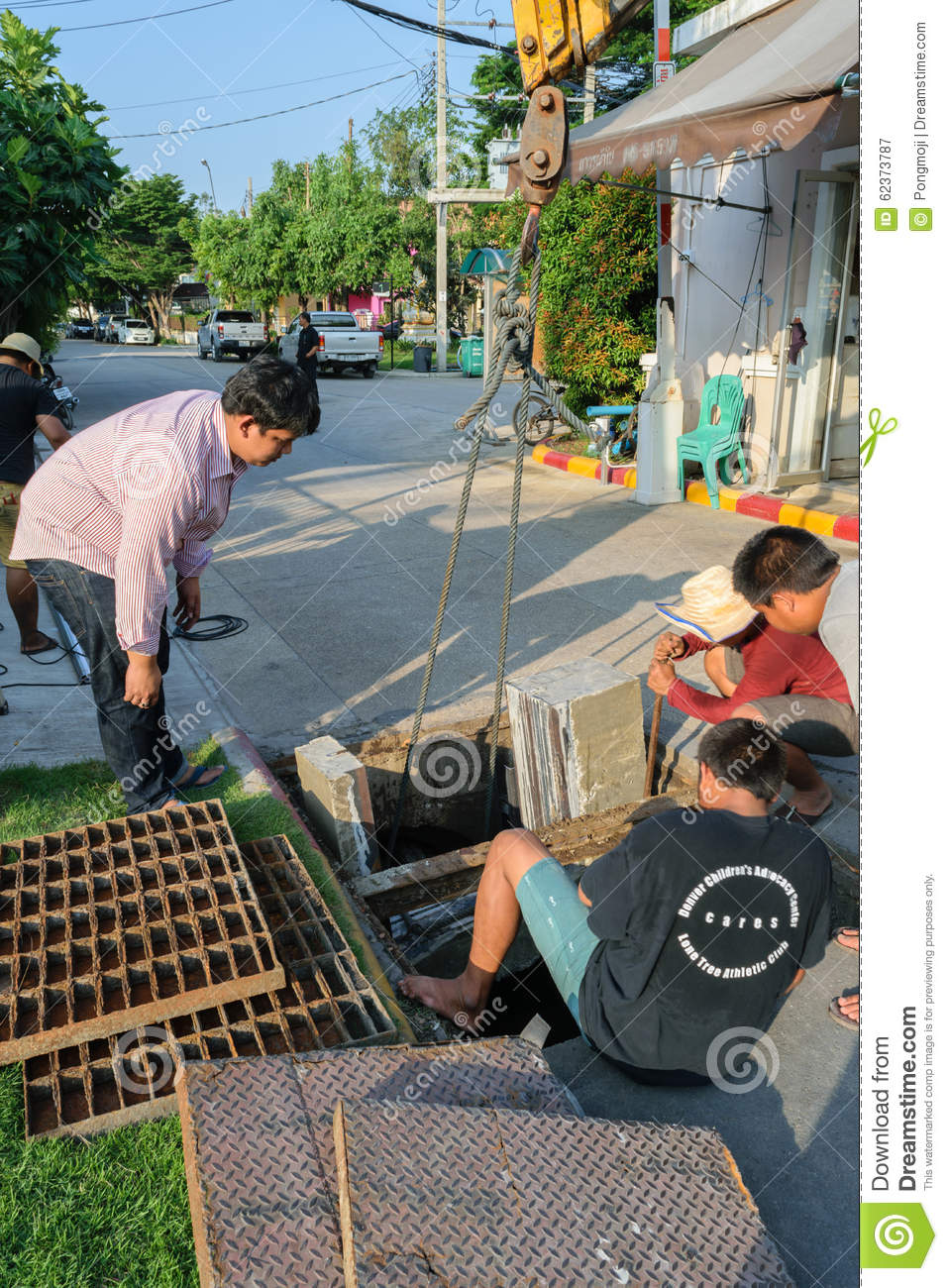 Working for drain cleaning editorial photography  Image of