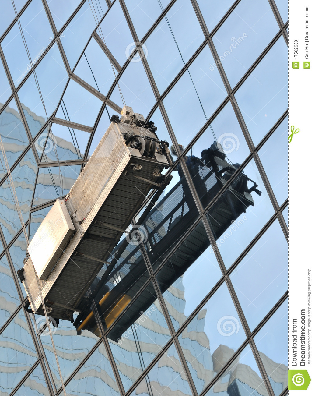Working on external glass wall of building stock photo for External glass walls