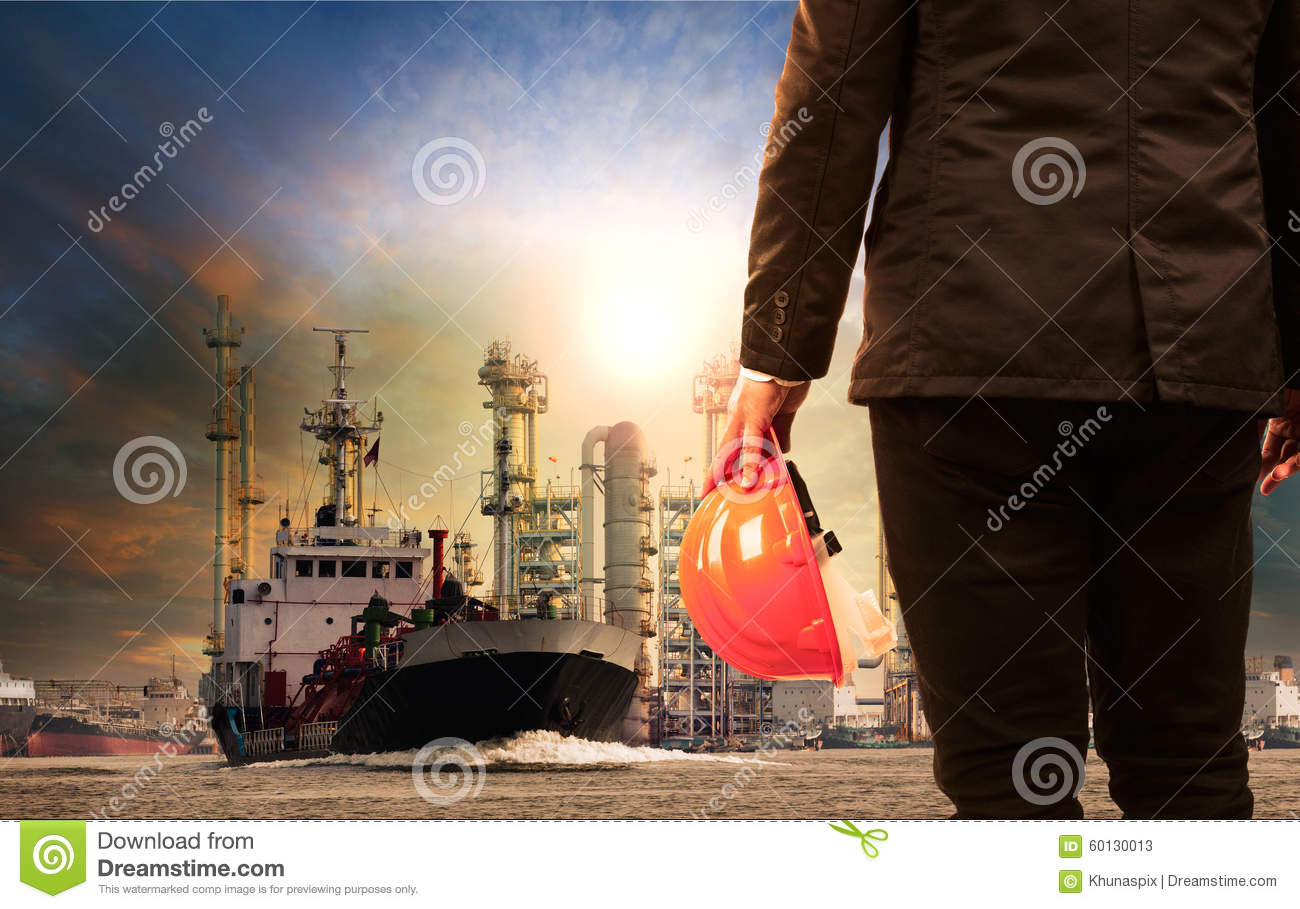 Working man and oil refinery with lpg gas storage ship transport