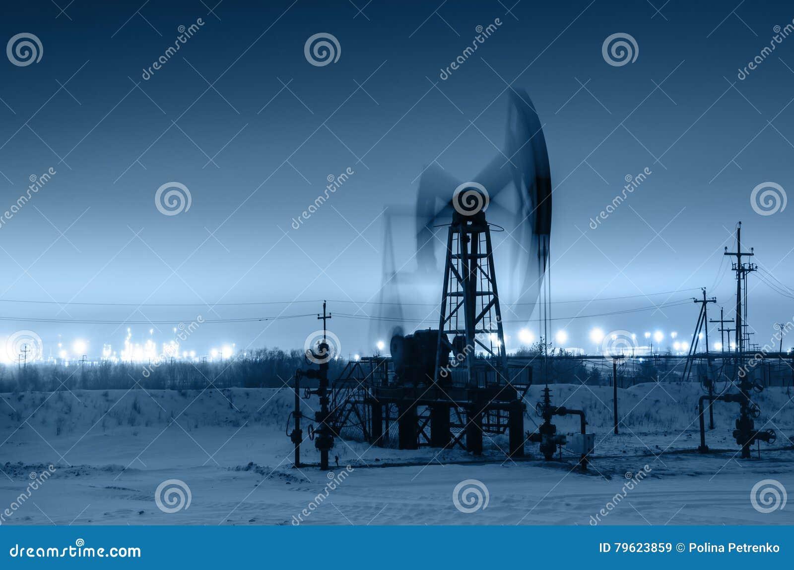 working-oil-pump-jack-night-time-oilfiel
