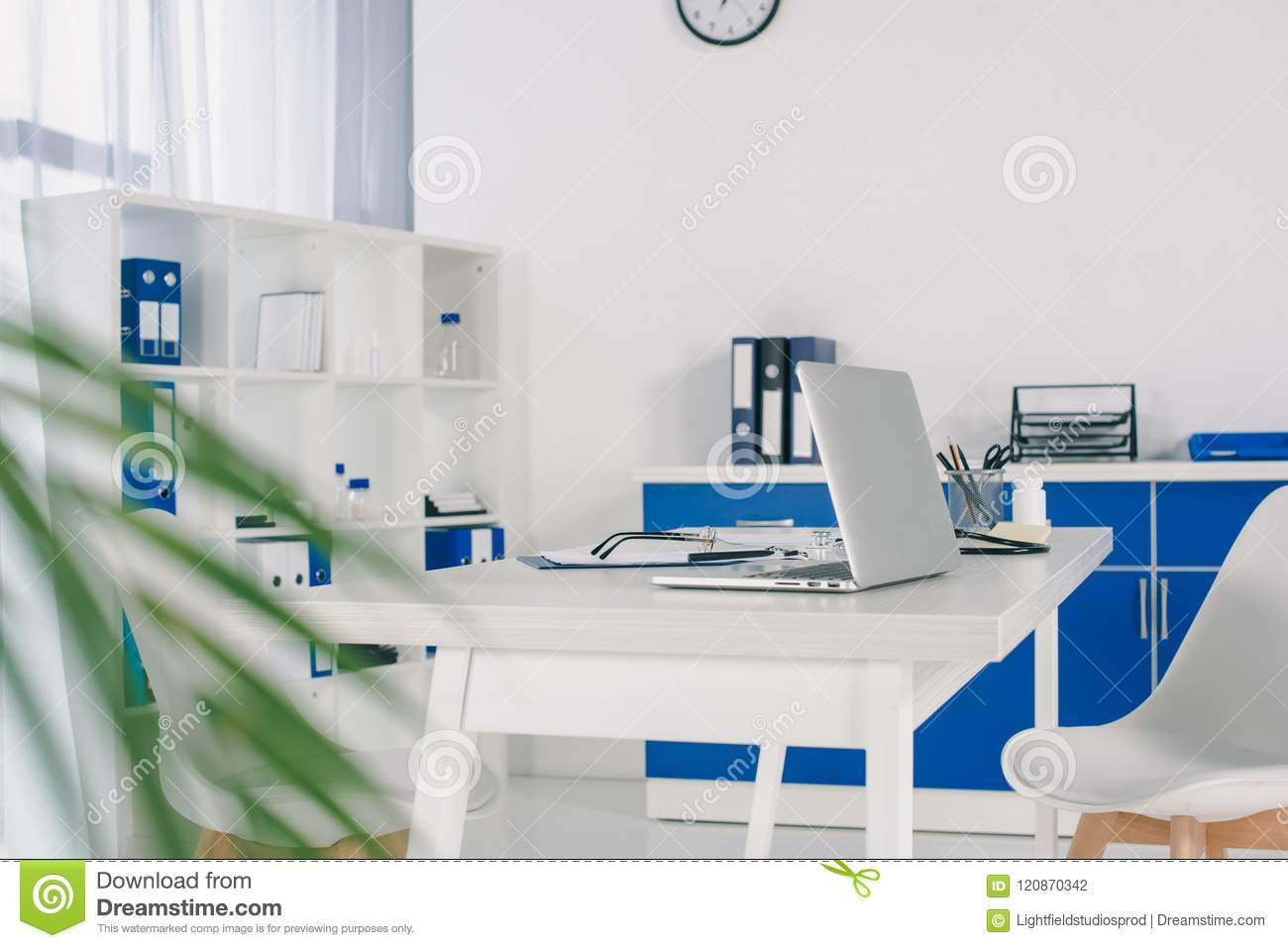 working place with laptop on table