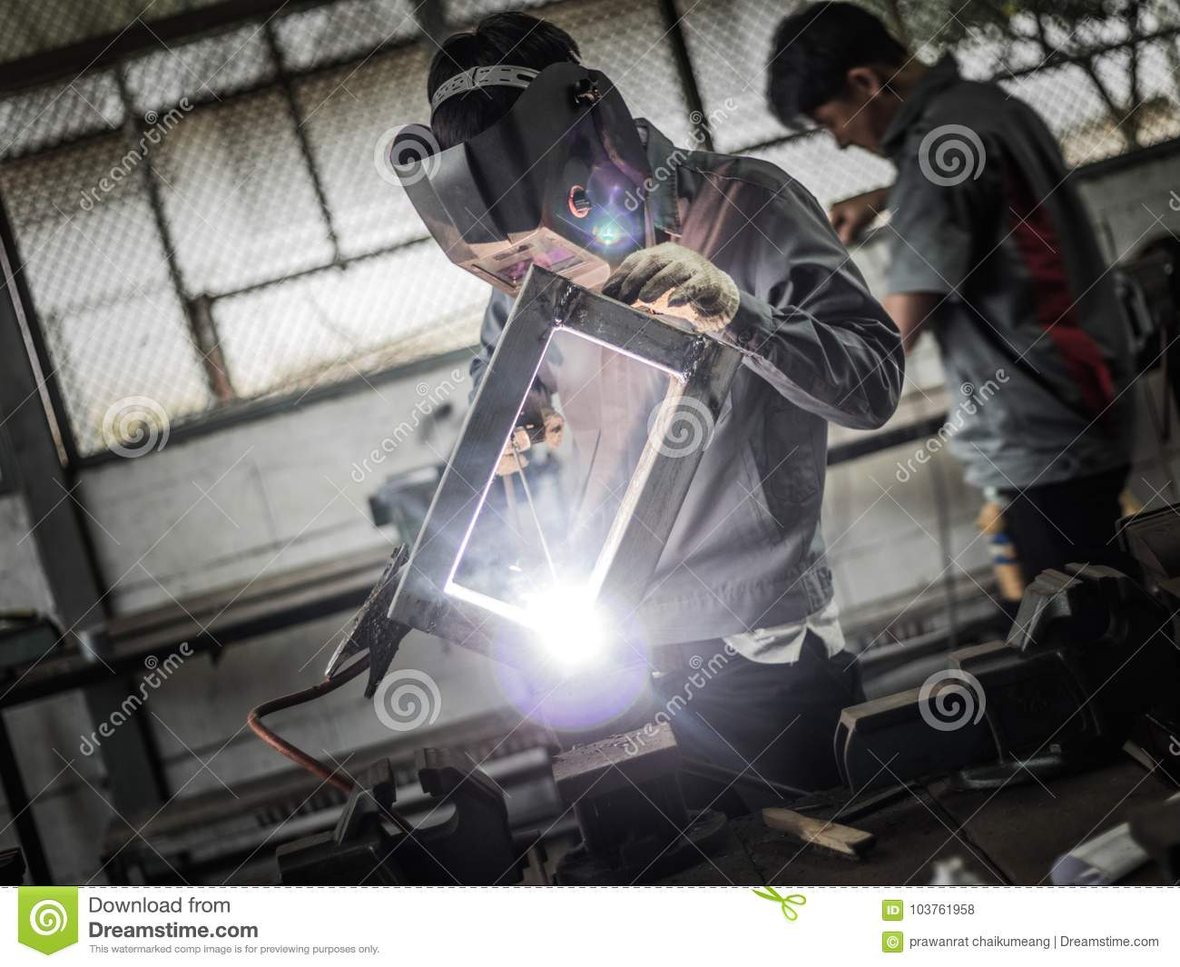 Working Welder In Action With Bright Sparks  Editorial Stock