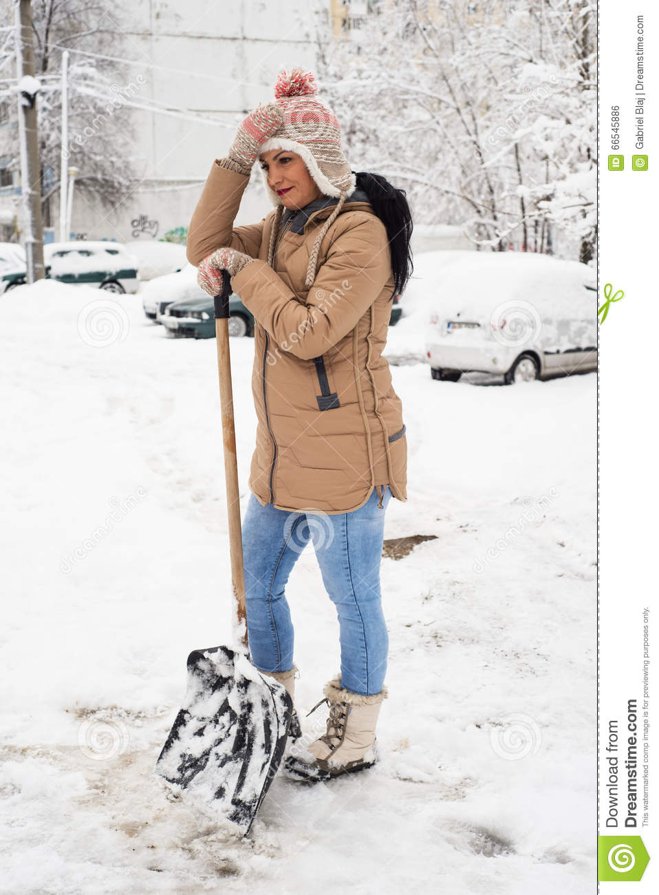 working woman with shovel remove snow stock photo image. Black Bedroom Furniture Sets. Home Design Ideas