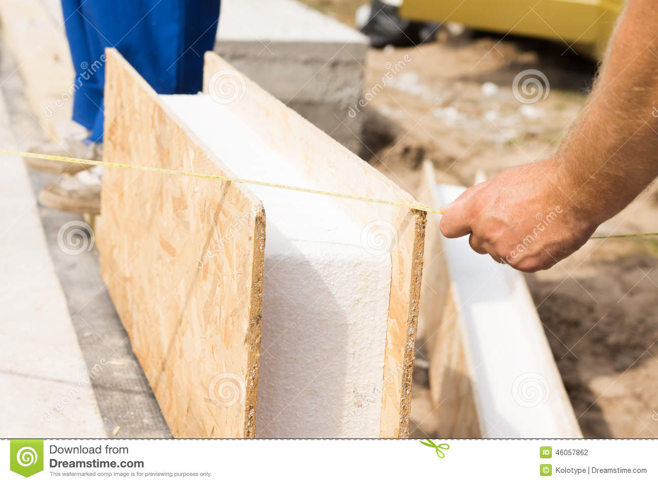 Workman Measuring A Prefab Wall Panel Stock Photo Image Of Foundation Group 46057862