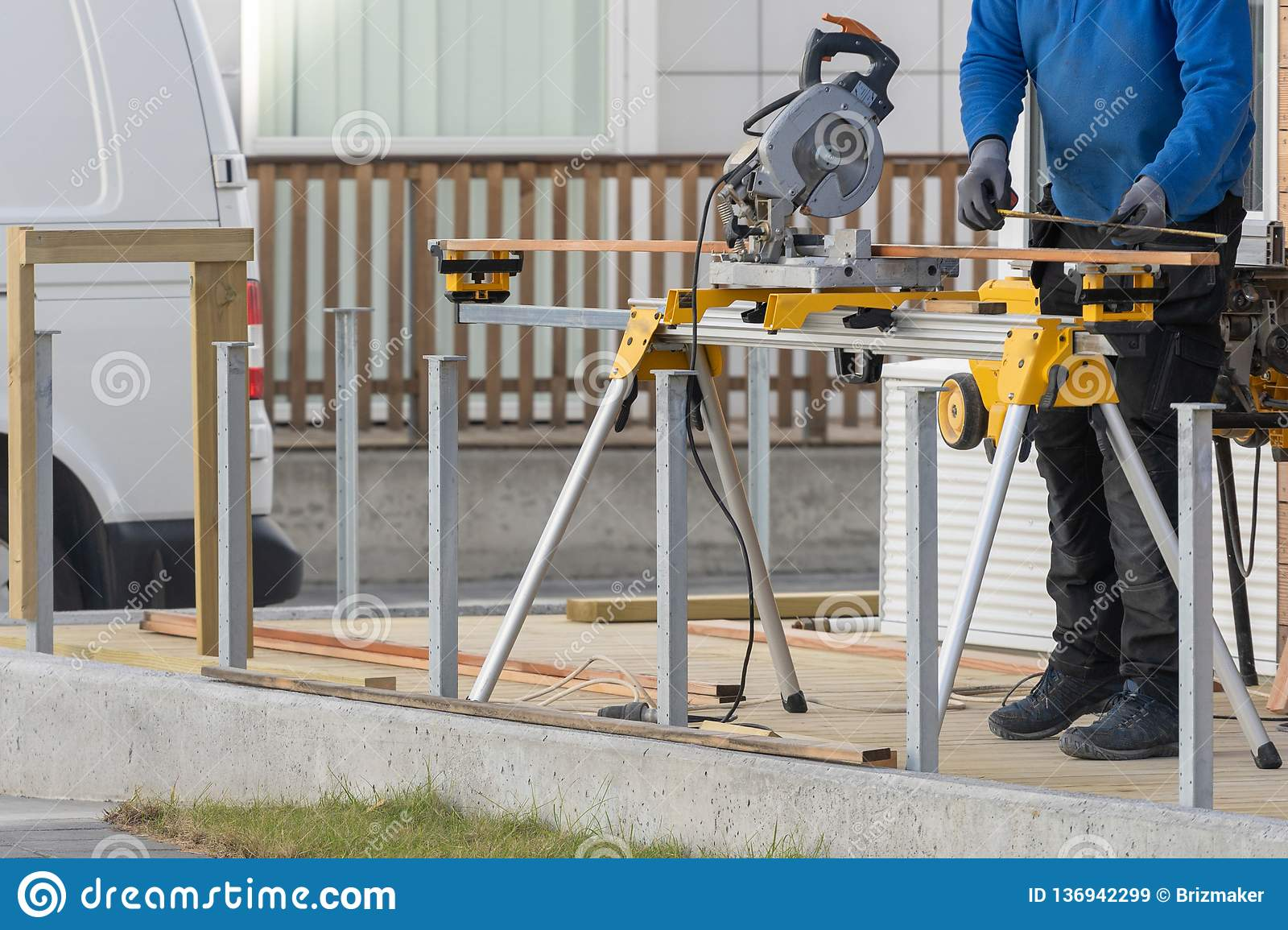 Workman Standing Near Chop Saw With Measure Type Stock Image