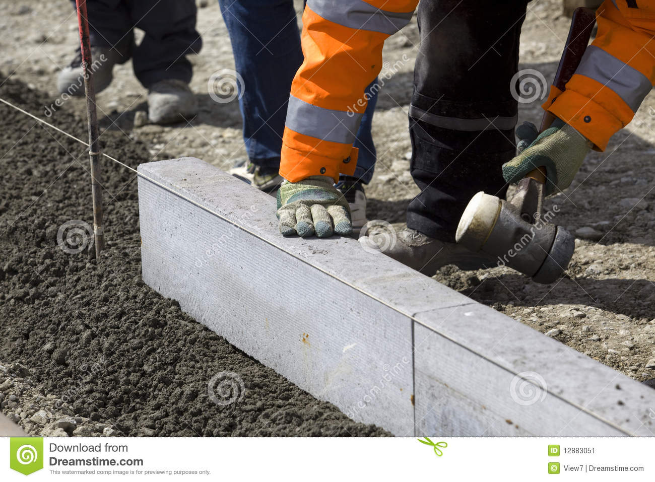 Workmen Laying Granite Slabs Stock Image - Image of