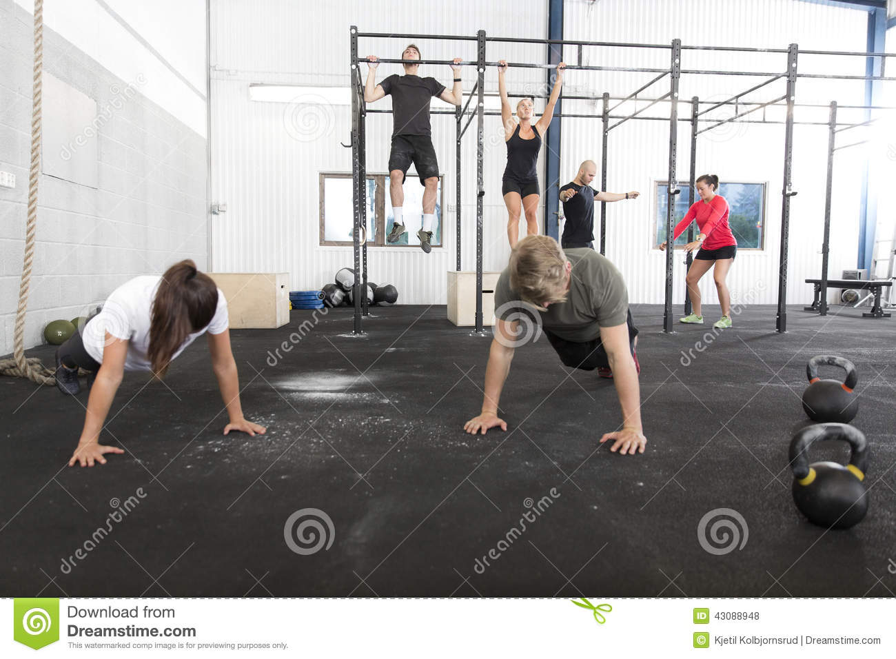Workout group trains exercises at fitness gym stock photo image