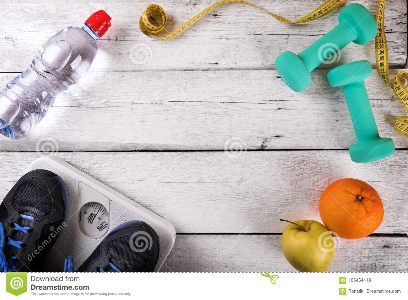 Workout items on white wooden gym floor with copy space