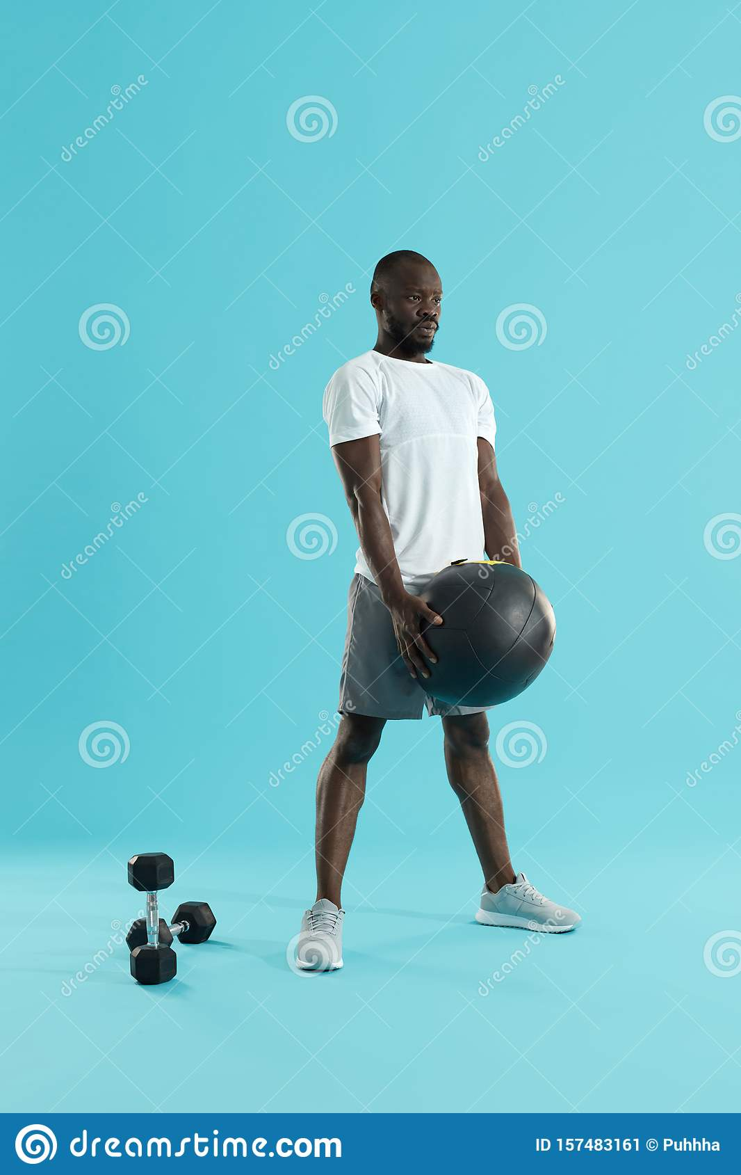 Workout. Sports man exercising with med ball, training