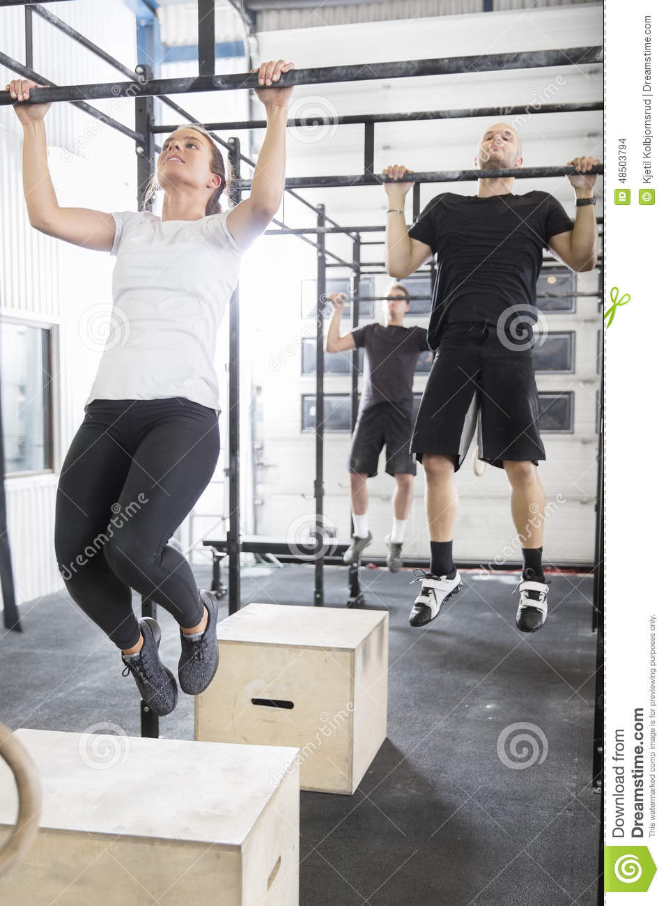 Workout team trains pullups at fitness gym stock photo image of