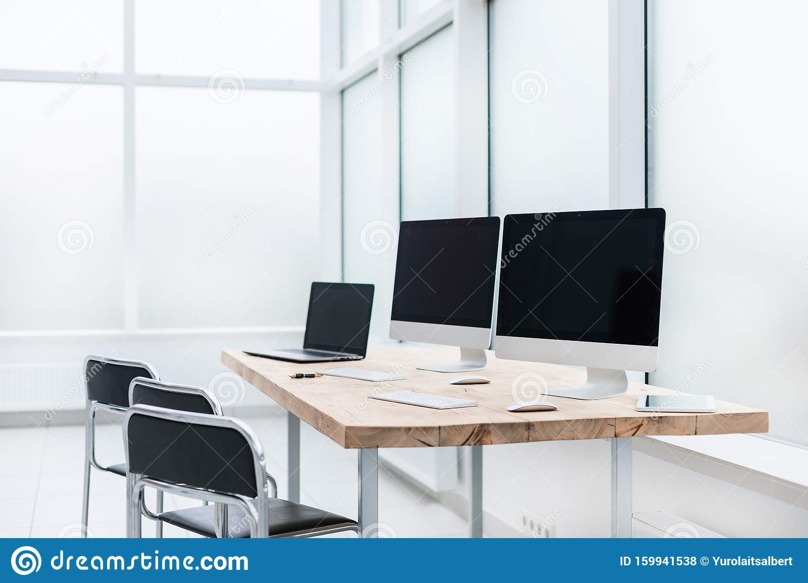 Workplace With Computers On The Table In An Empty Office Stock Photo Image Of Interior Laptop 159941538