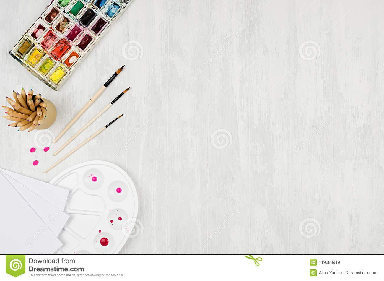Workplace for drawings watercolor paints palette brushes