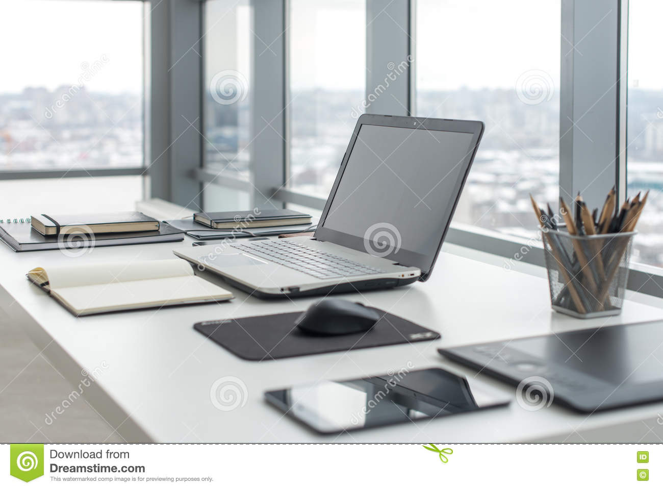 work tables office. Workplace With Notebook Laptop Comfortable Work Table In Office Windows And City View. Stock Image - Of Side, Creative: 74482403 Tables