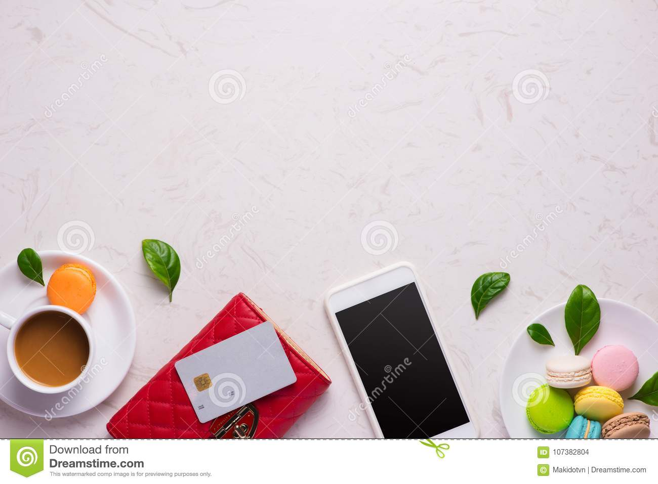 Workplace with stylish red leather wallet and smartphone