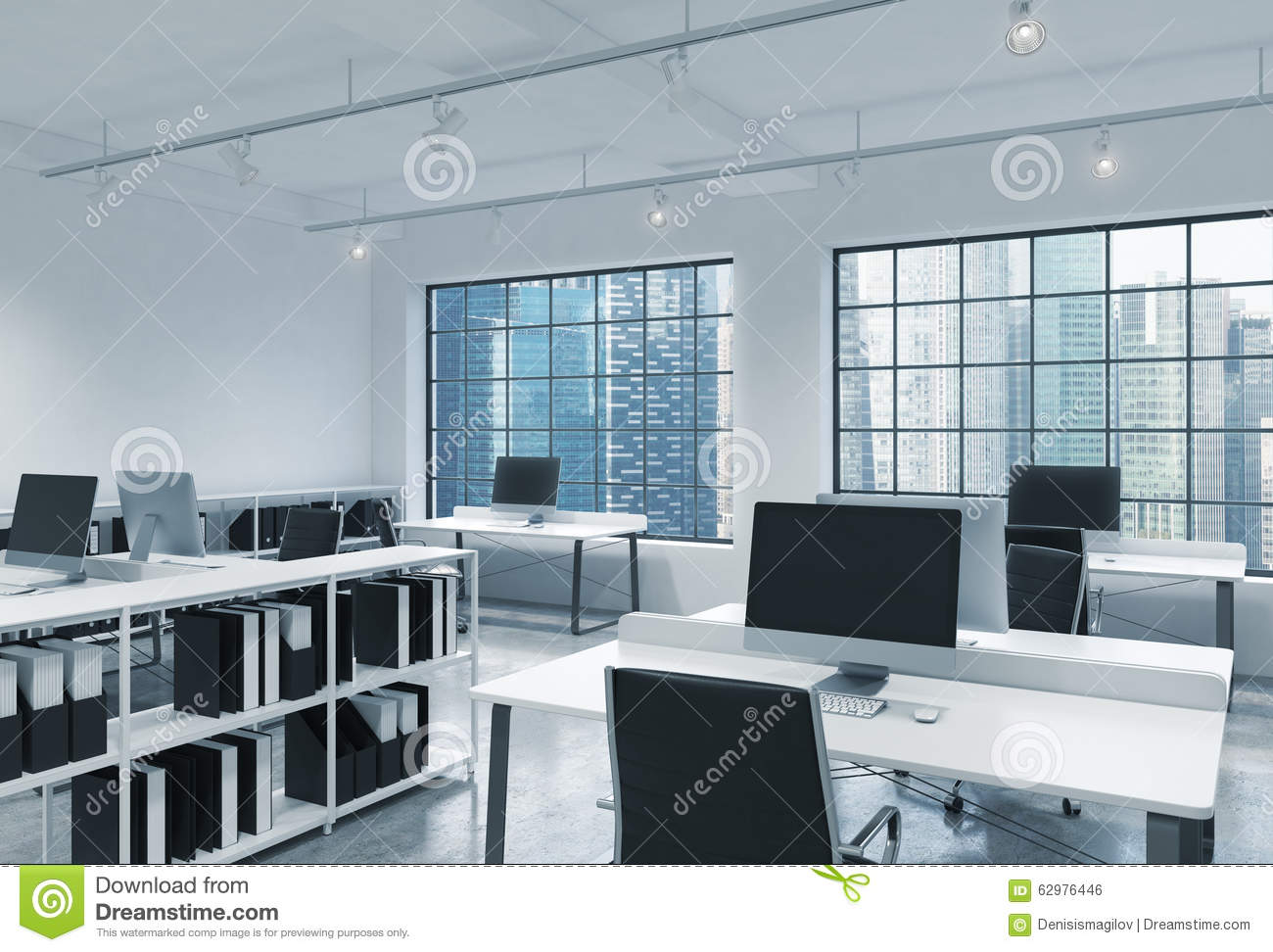 workplaces in a bright modern loft open space office tables are equipped with modern computers bright modern office space