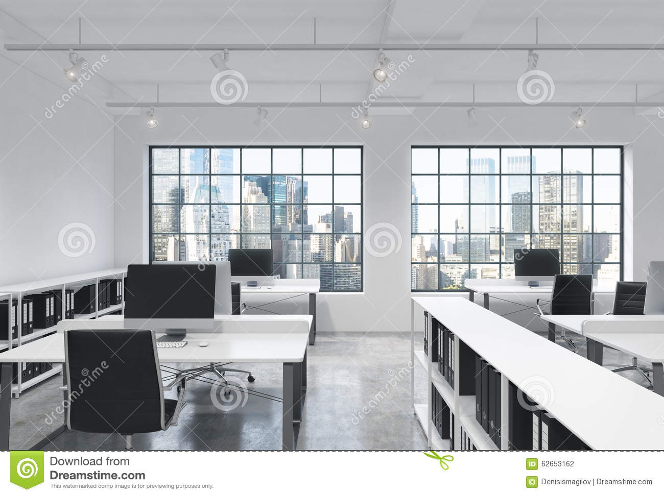 Modern Loft workplaces in a bright modern loft open space office. tables are