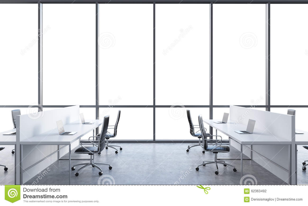 workplaces in a bright modern open space office white tables equipped with modern laptops and bright modern office space