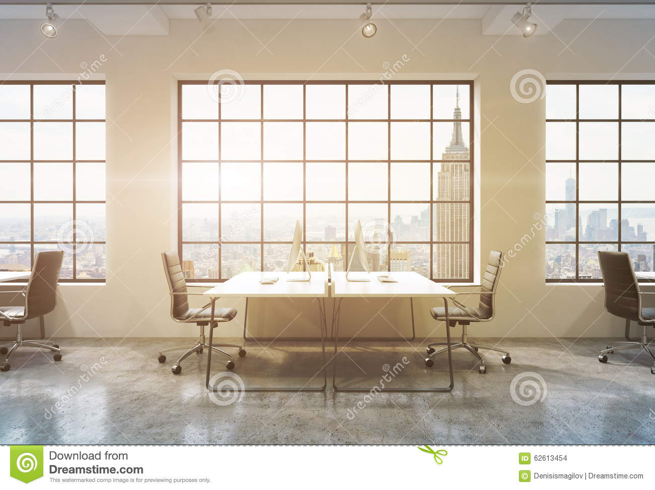 Workplaces in a sunset loft open space office tables are equipped with computers stock - Small office space nyc concept ...