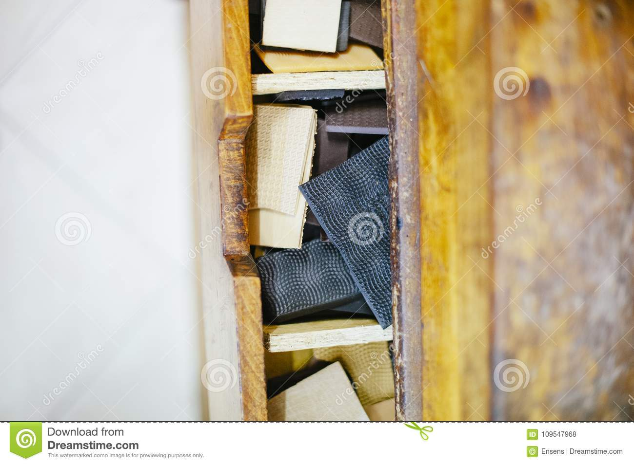 559f66c21cbc9 Shoemaker Workshop Chest With Pieces Of Sole Seen From Above Stock ...