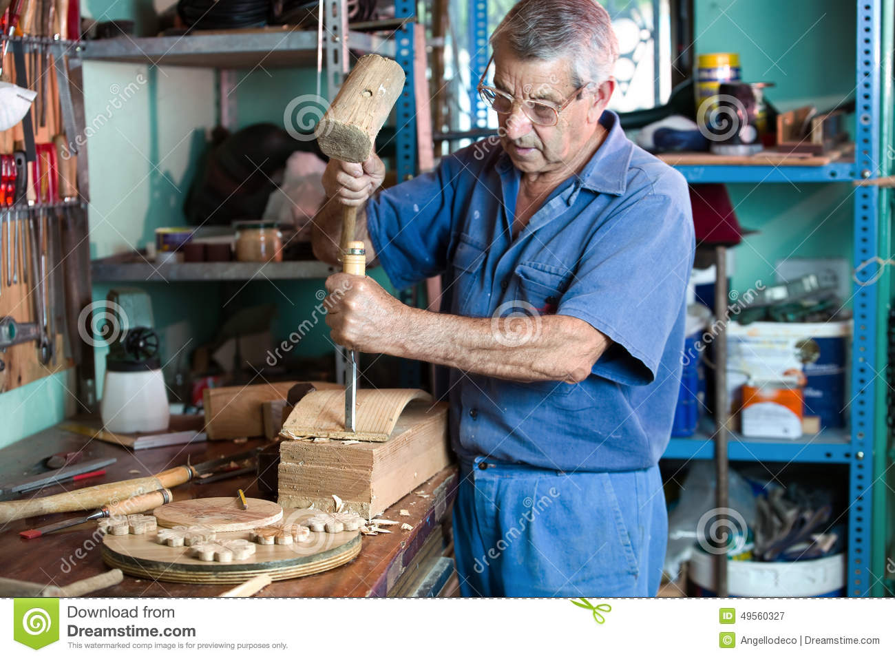 cabinetmaker carving wood with a chisel and hammer stock. Black Bedroom Furniture Sets. Home Design Ideas