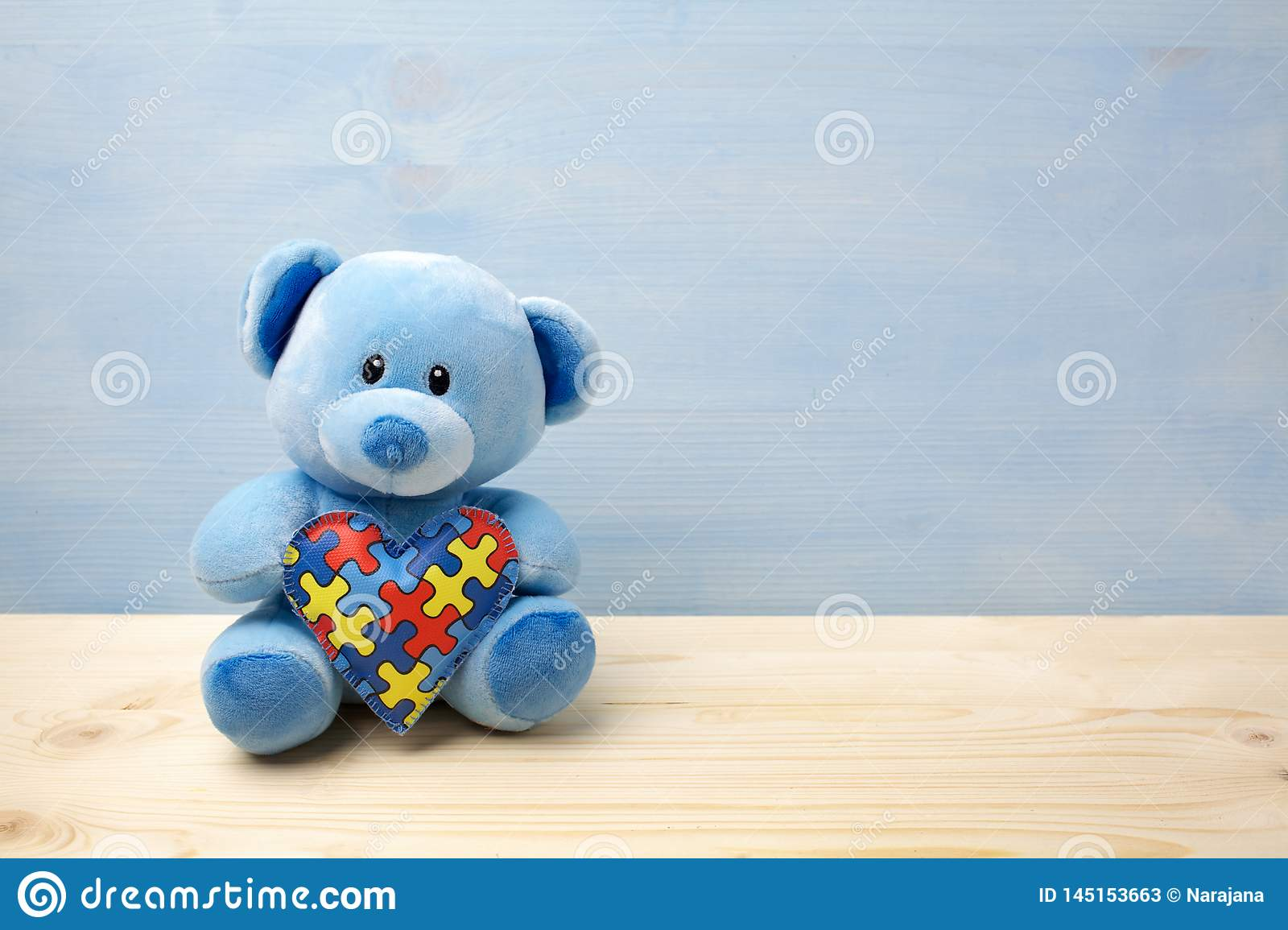 World Autism Awareness Day Concept With Teddy Bear Holding Puzzle