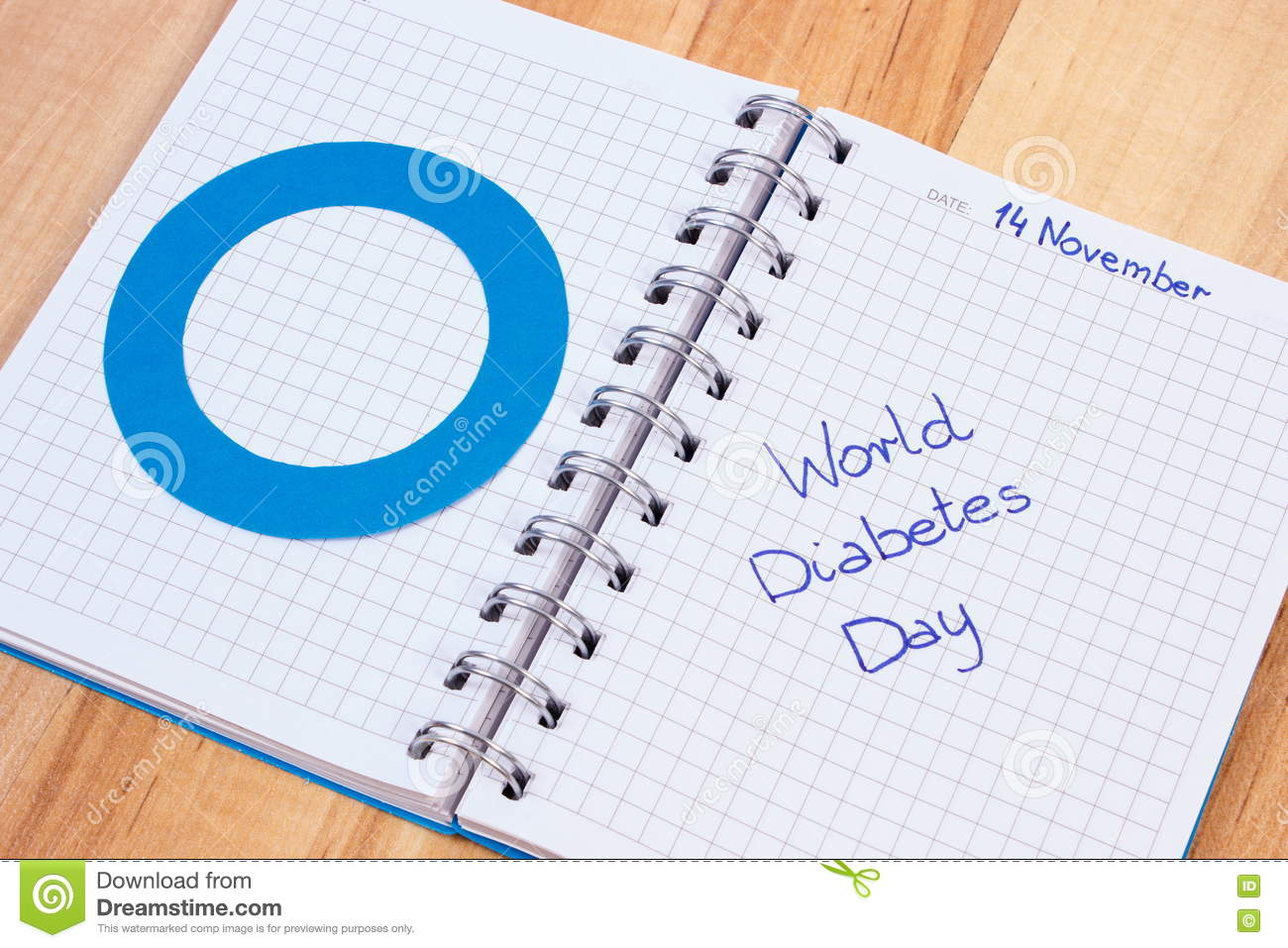 world diabetes day written in notebook and blue circle symbol of world diabetes day written in notebook and blue circle symbol of diabetic
