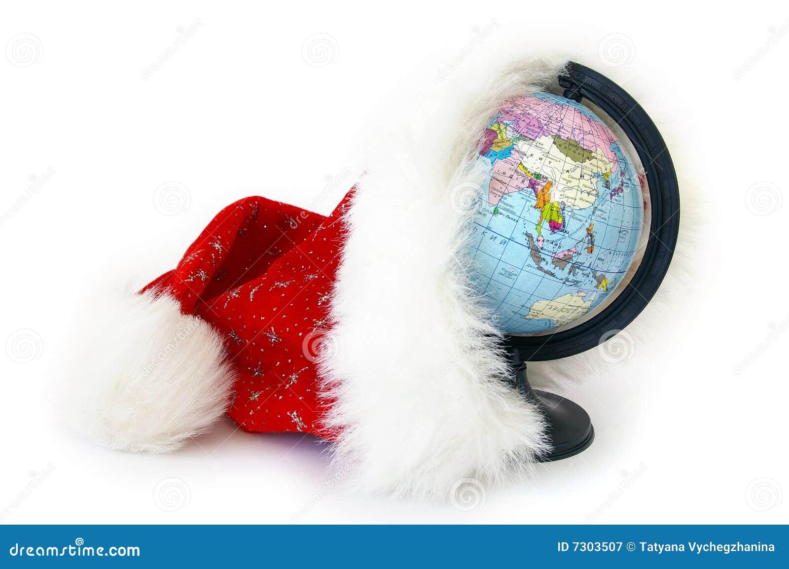 World globe and santa claus hat royalty free stock