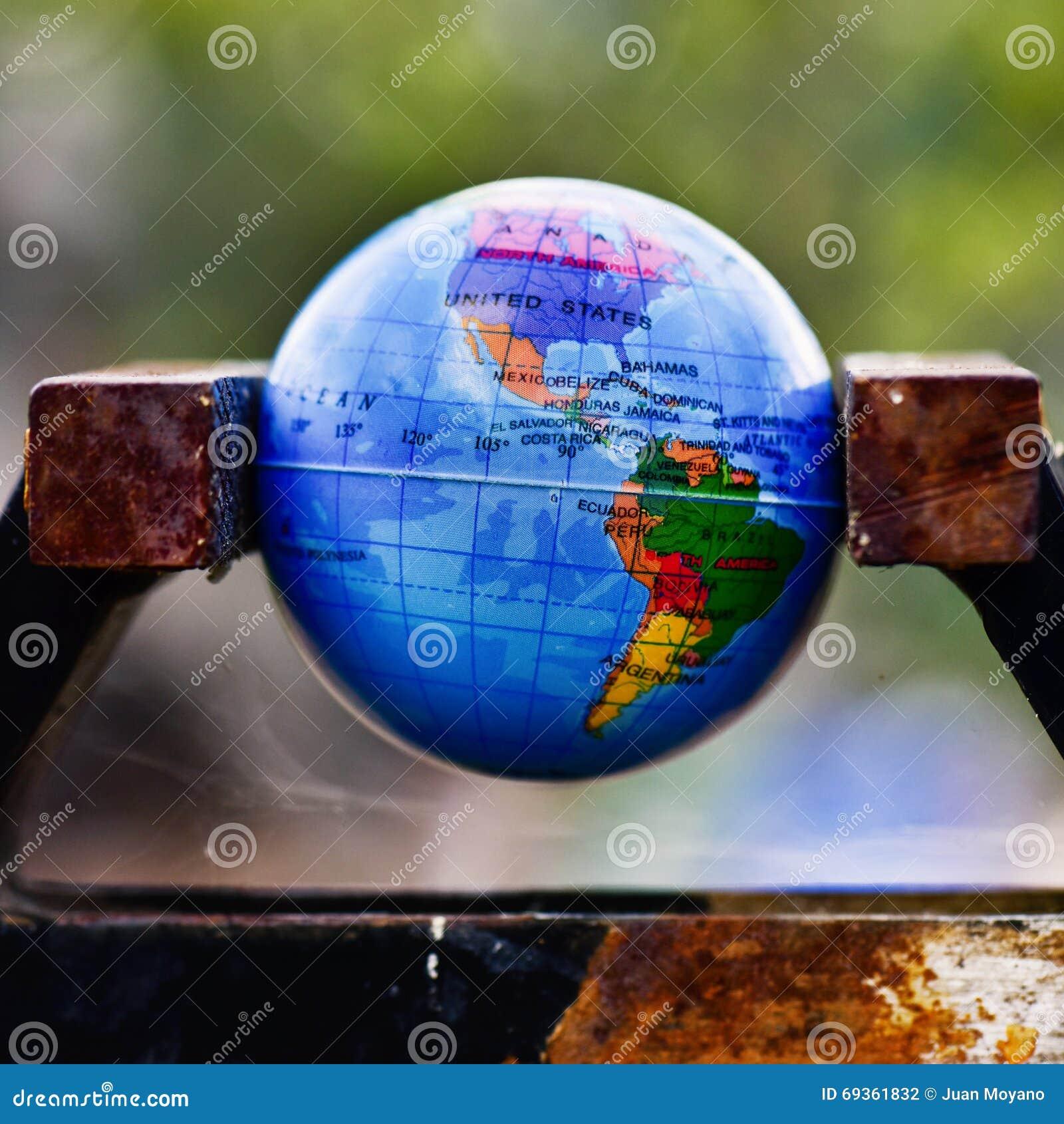 World globe in a vise