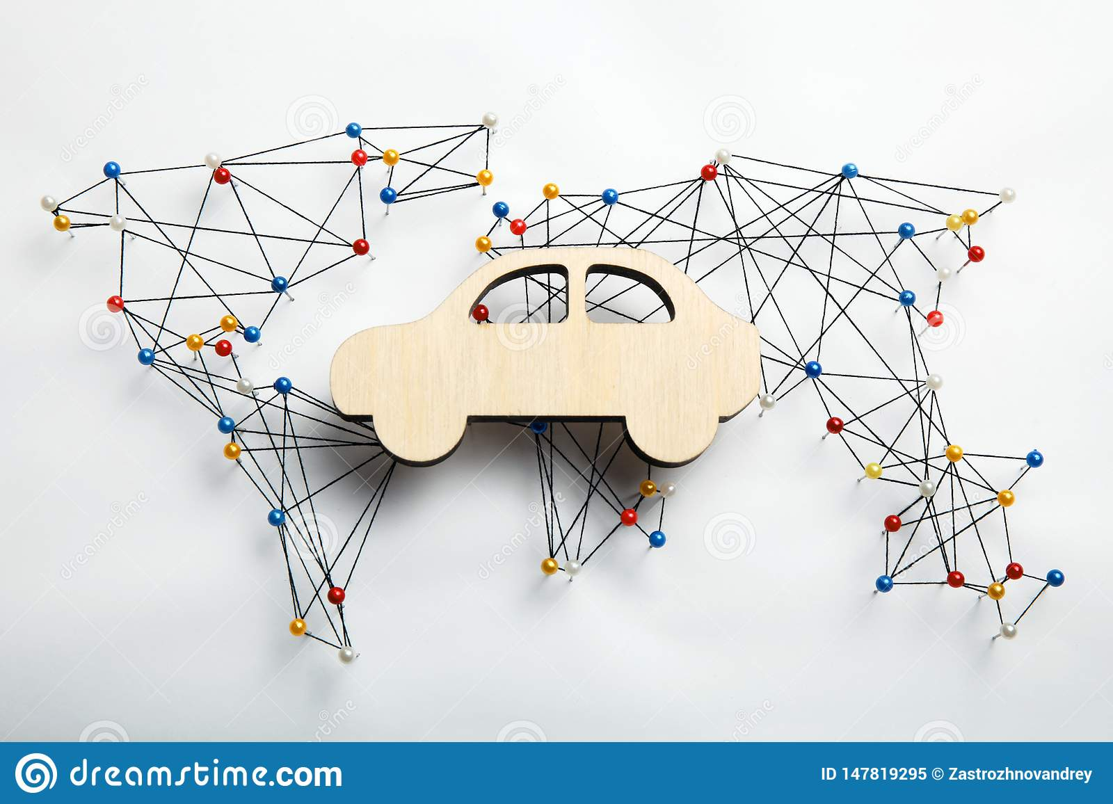 World infrastructure map and wooden car figure