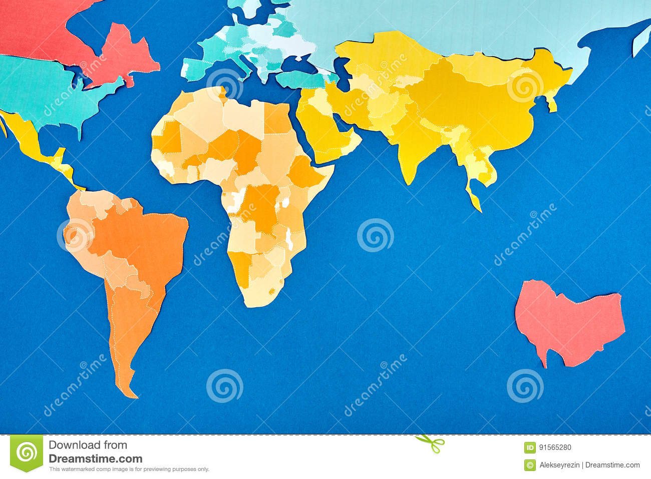 World Map Cut Out Of Colored Paper Based On Blue. Stock ...
