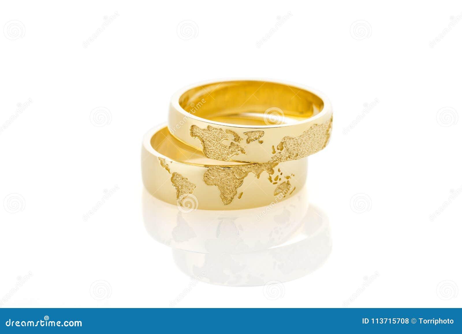 World Map Golden Wedding Rings Isolated On White Background Stock