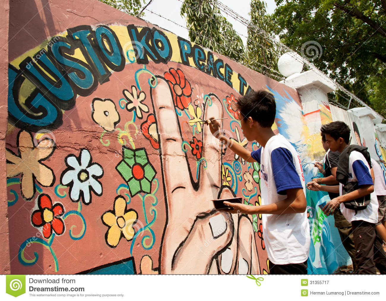 World record peace mural painting in manila philippines for A mural is painted on a