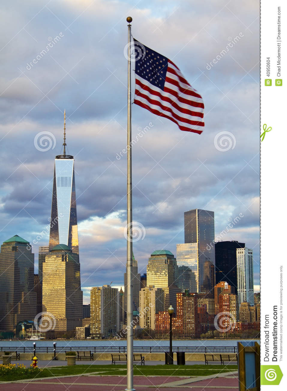 ... Tower in Lower Manhattan New York City skyline with American Flag