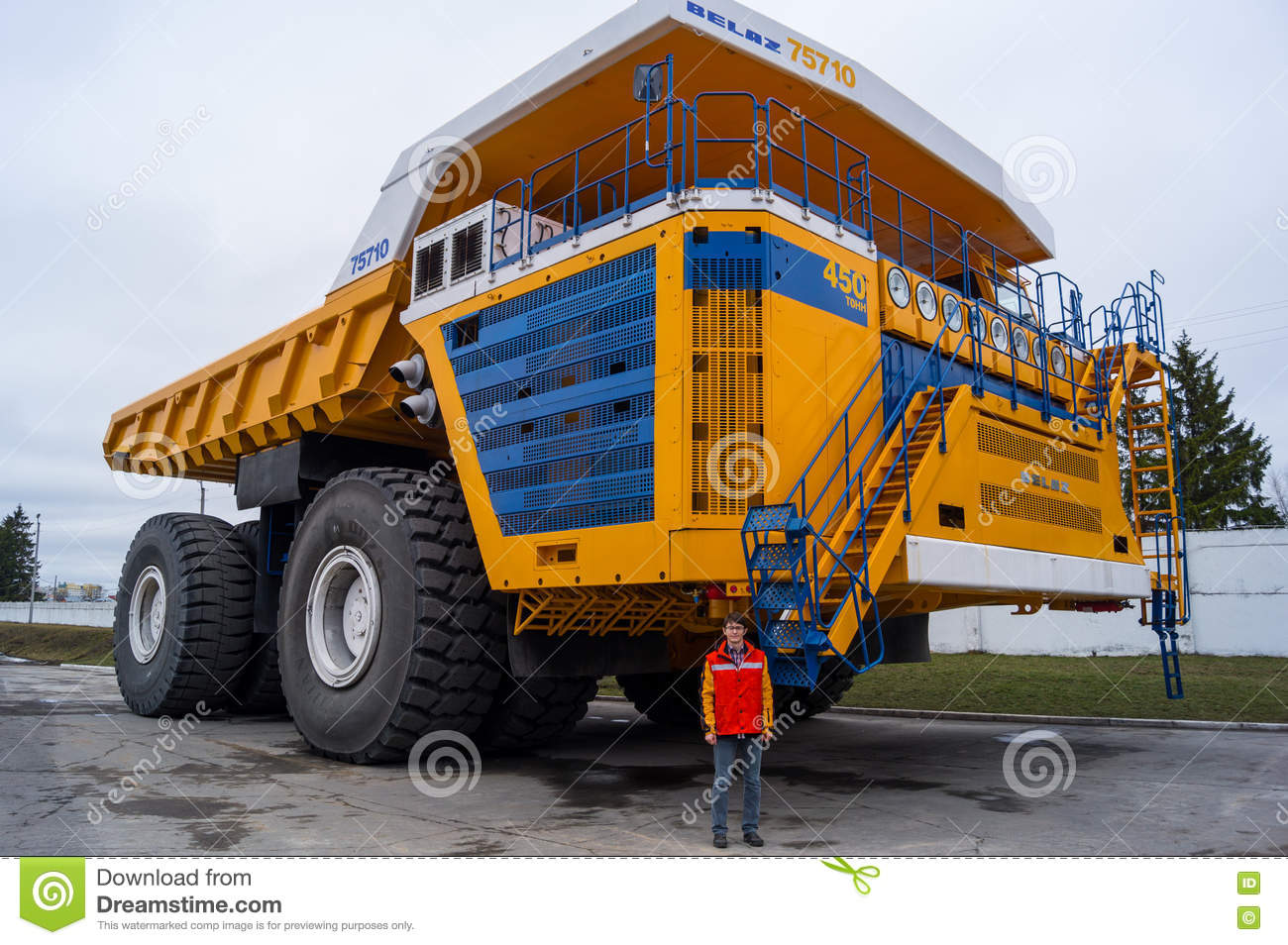 world 39 s largest huge truck belaz with man for scale editorial photo image 72889521. Black Bedroom Furniture Sets. Home Design Ideas