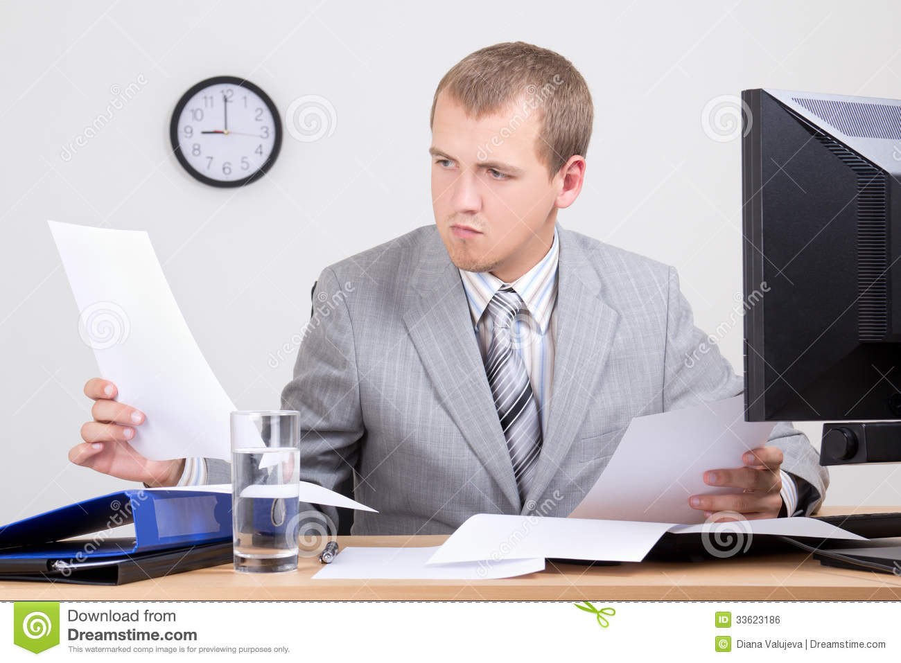 Worried Accountant Doing Paperwork In Office Royalty Free