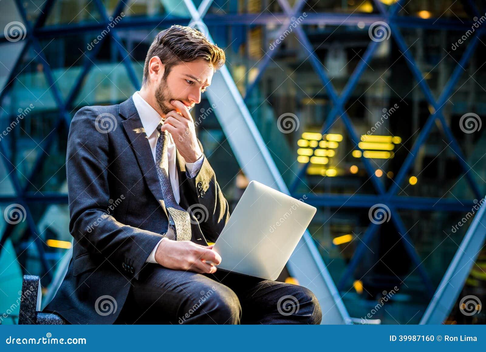 Worried businessman on laptop computer