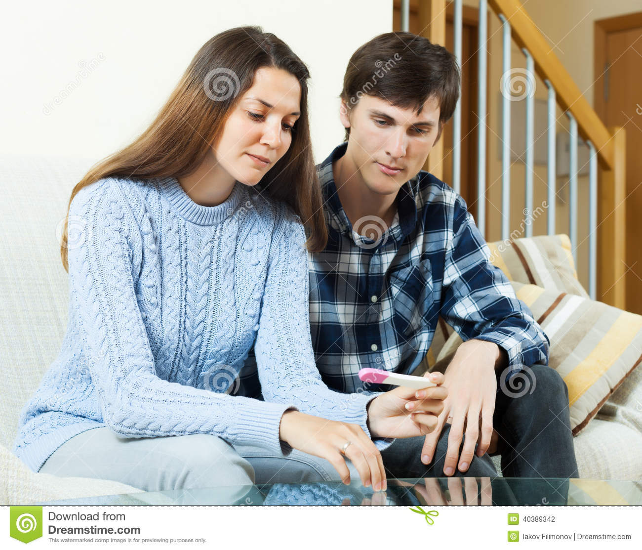 worried couple with pregnancy test stock photo image 40389342. Black Bedroom Furniture Sets. Home Design Ideas