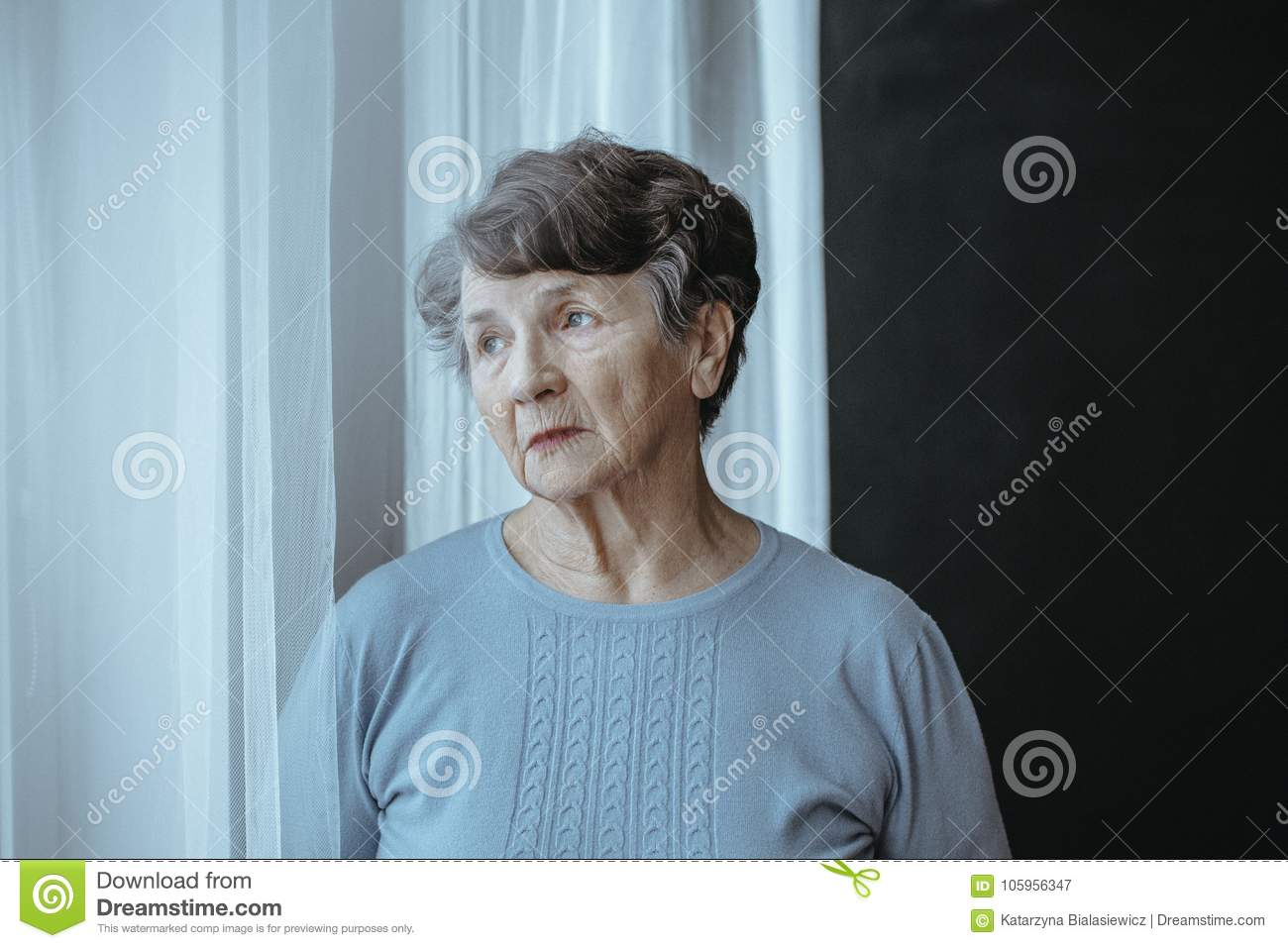 Worried grandmother with alzheimer`s disease