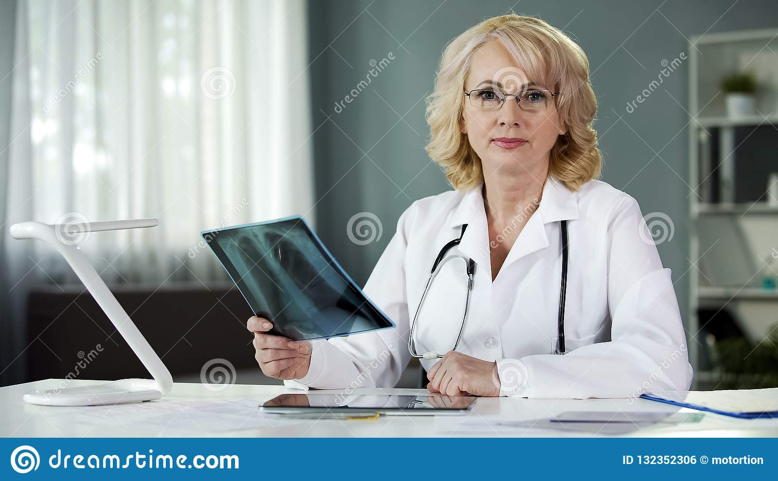 Worried about patient s health doctor seriously looking into camera, medicine