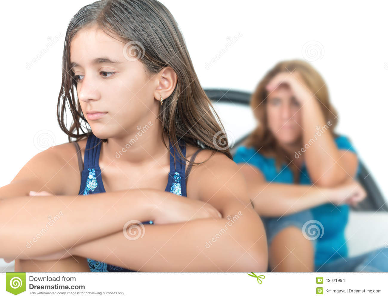 Worried and thoughtful teenage girl with her mother