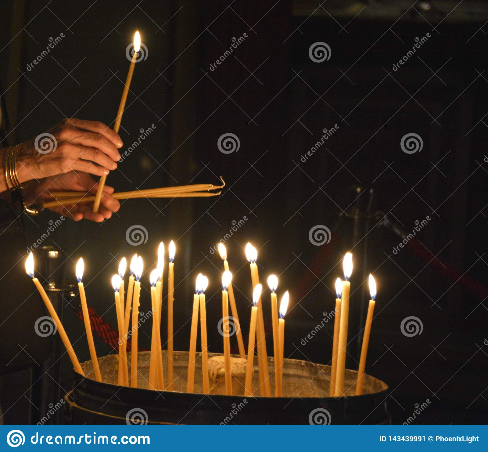 A Worshipper Lights Candles At The Church Of The Holy ...