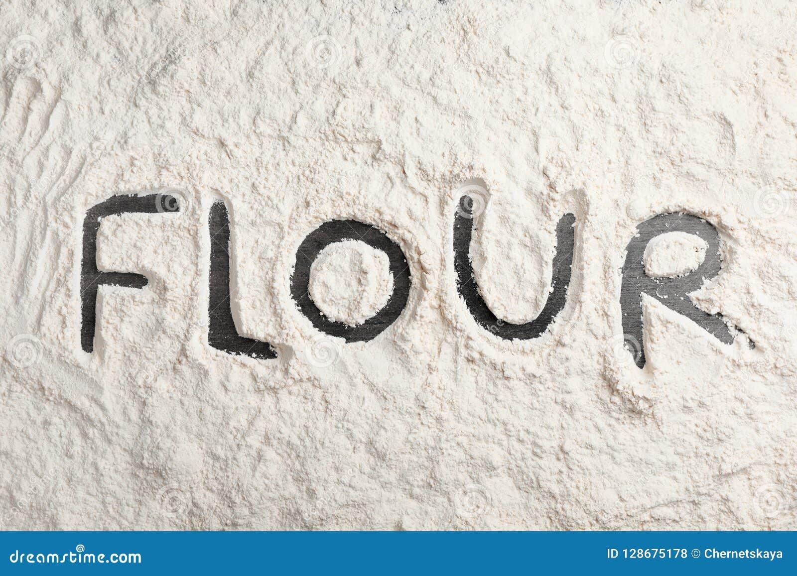 Wort geschrieben auf Schicht Mehl