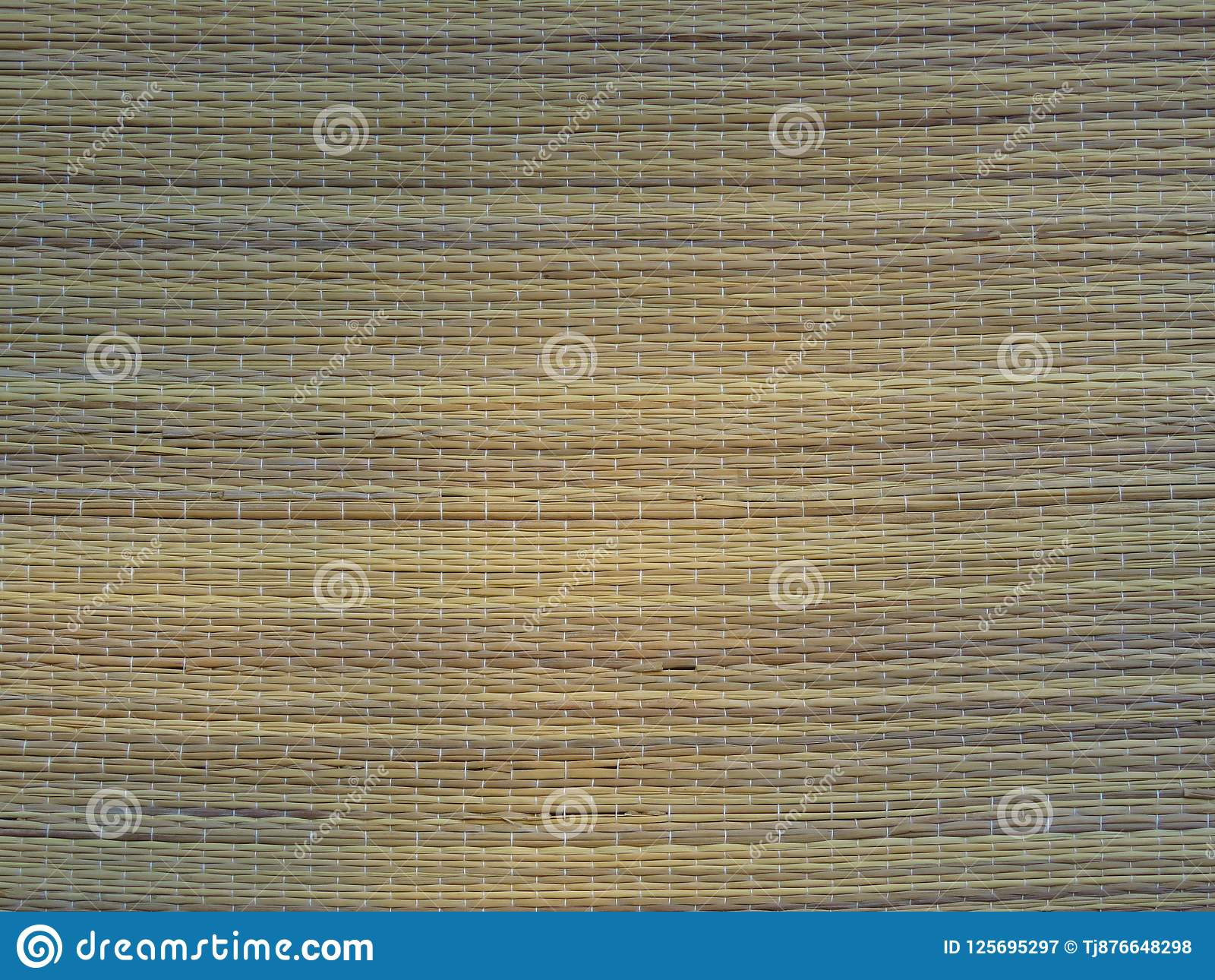 Woven Bamboo Mat Background Straw Weave Texture. Rustic lifestyle.