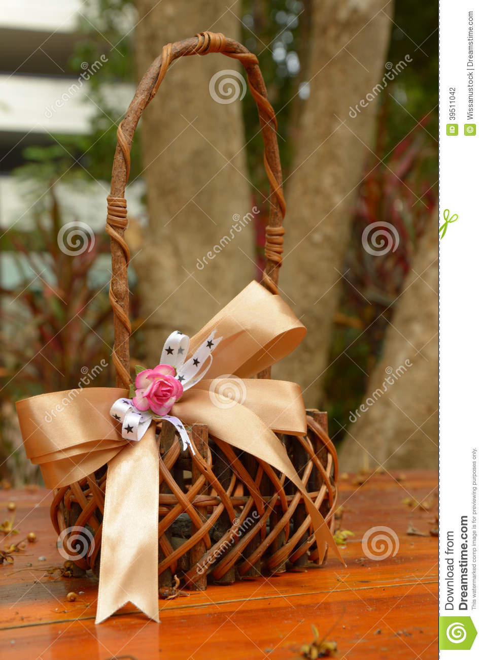 Woven basket with ribbon